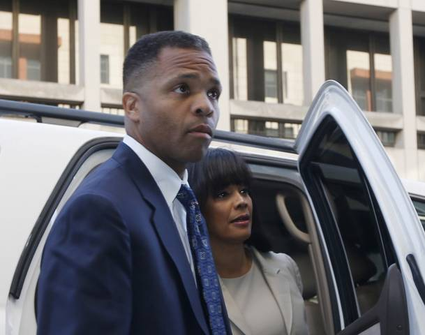 Jackson Jr. and his wife arrive at court for their sentencing hearing in Washington